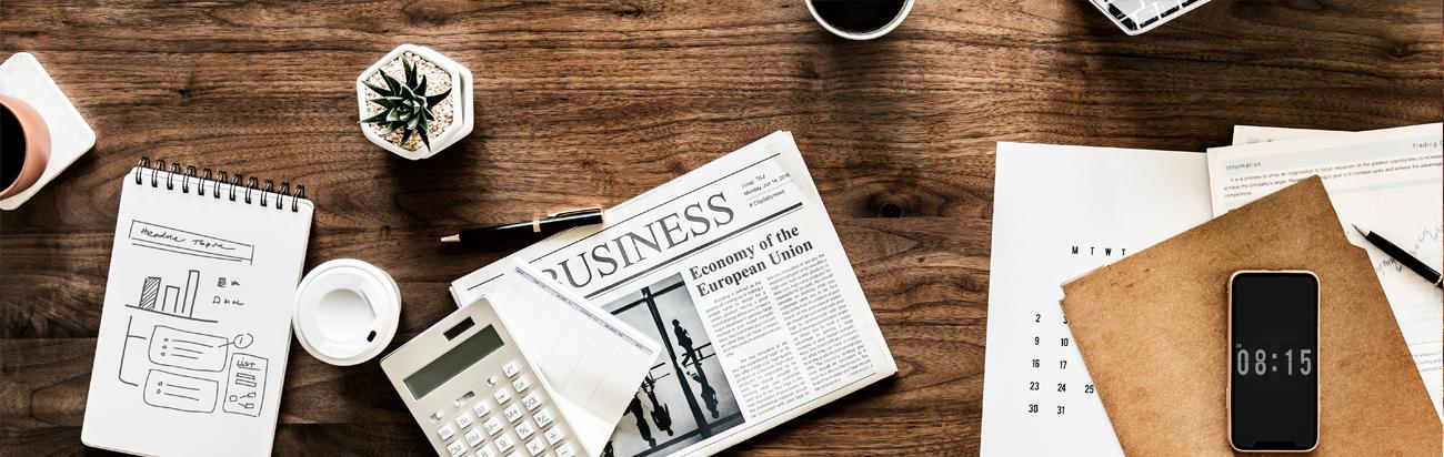 newspaper on desk News Parsons FCU